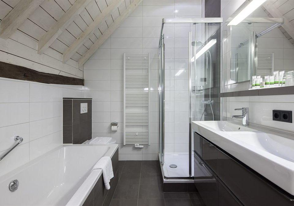 bathroom toilet property sink home daylighting flooring tub bathtub Bath tiled