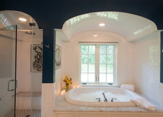 bathroom property white swimming pool sink lighting daylighting bathtub tub Bath tile painted tiled