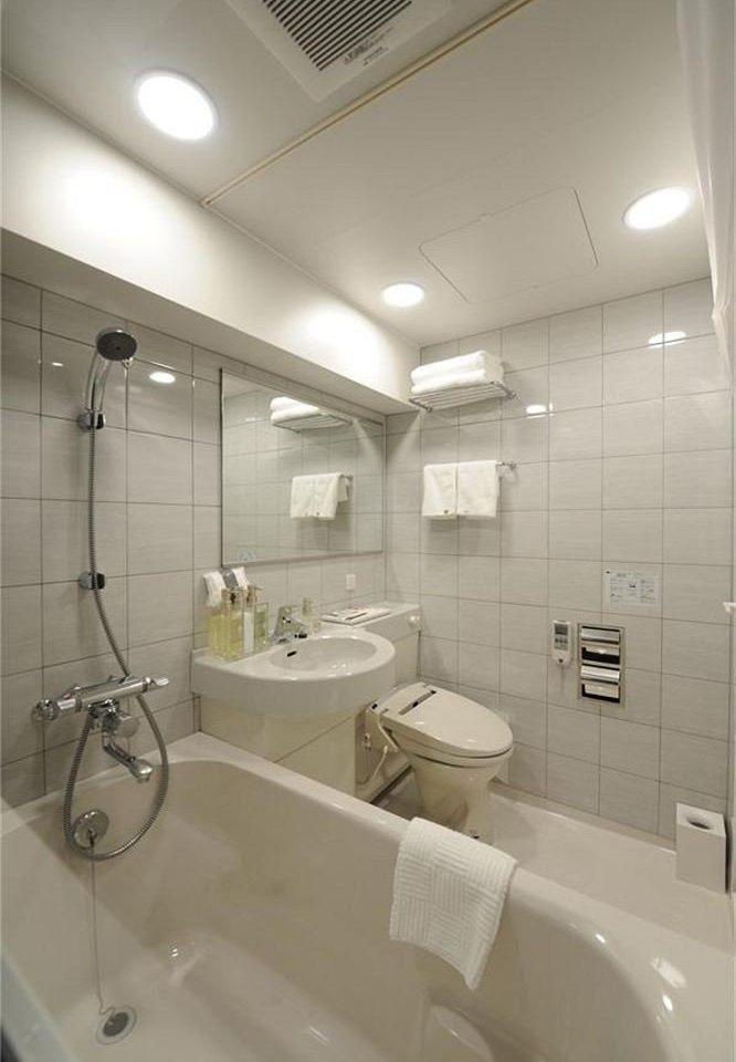 bathroom toilet sink plumbing fixture daylighting tub bathtub Bath tile tiled