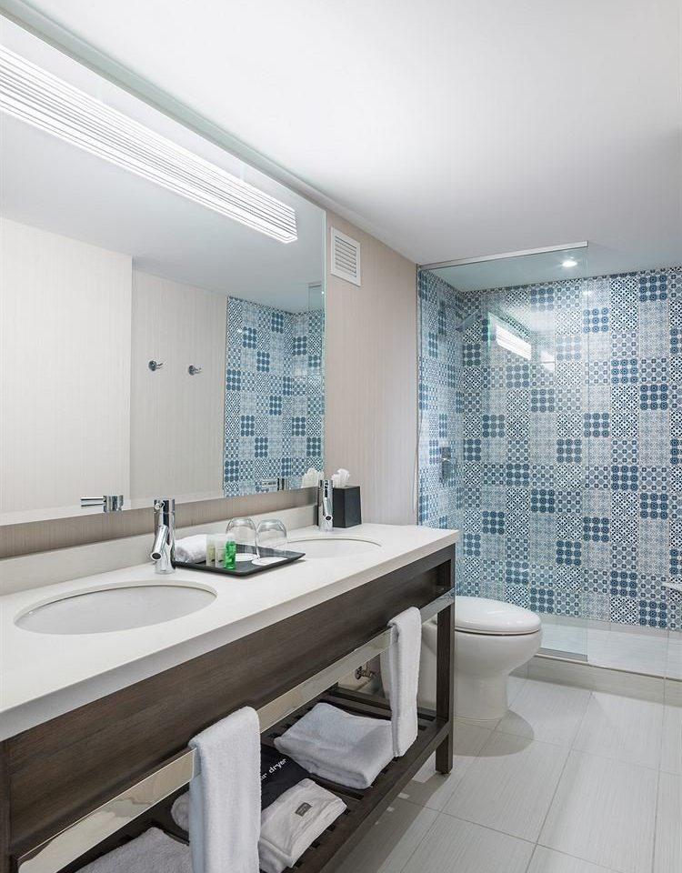 bathroom sink property bathtub swimming pool daylighting plumbing fixture flooring tile tub Bath