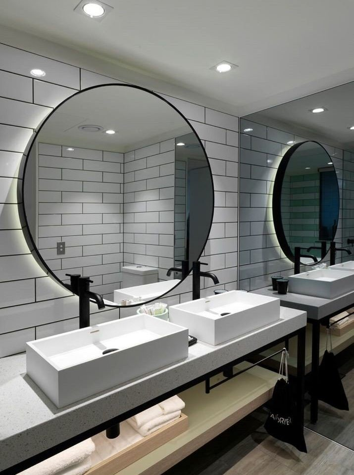 bathroom mirror sink daylighting long tile tiled Bath tub bathtub