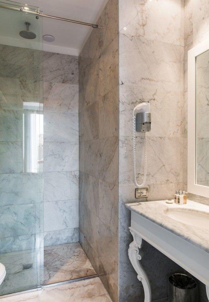 bathroom sink toilet house plumbing fixture home flooring tile plaster tub tiled bathtub Bath dirty water basin tan