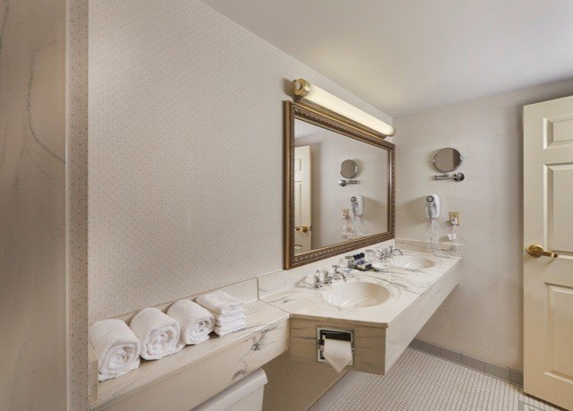 bathroom mirror sink property home toilet flooring vanity Bath bathtub