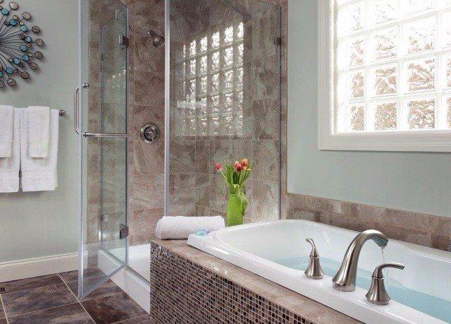 bathroom sink property bathtub flooring plumbing fixture tile Bath tub tiled