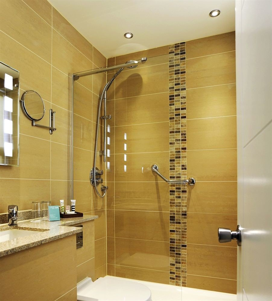 bathroom toilet sink plumbing fixture flooring tile tiled tub bathtub Bath