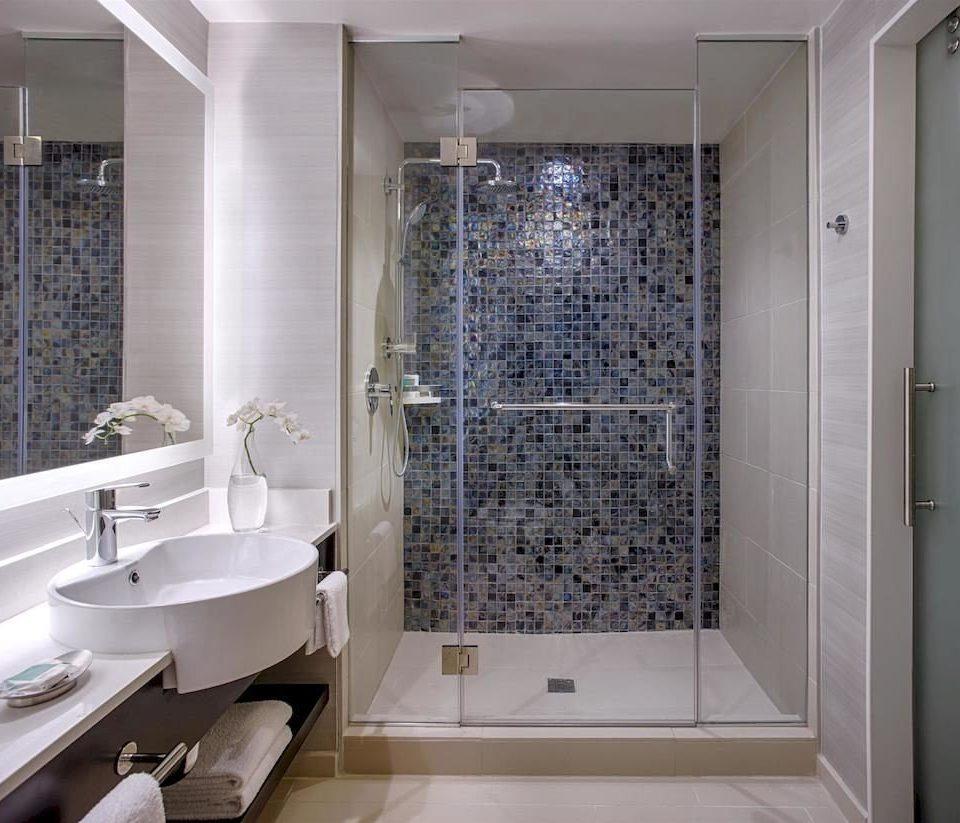 bathroom property toilet sink plumbing fixture flooring bathtub tile tiled tub Bath
