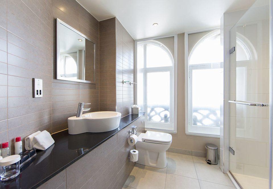 bathroom property sink home flooring tub Bath bathtub tiled