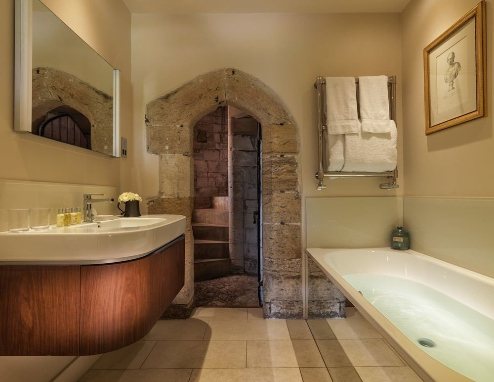 bathroom sink tub home toilet Bath flooring bathtub plumbing fixture stone tile tiled tan