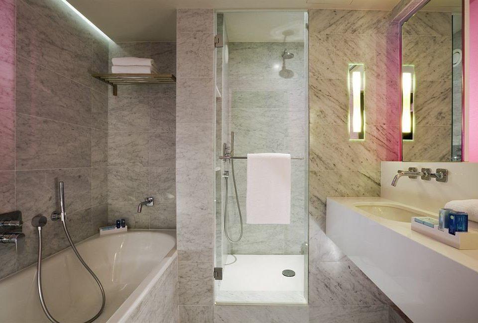 bathroom sink property toilet home plumbing fixture flooring Bath tub bathtub