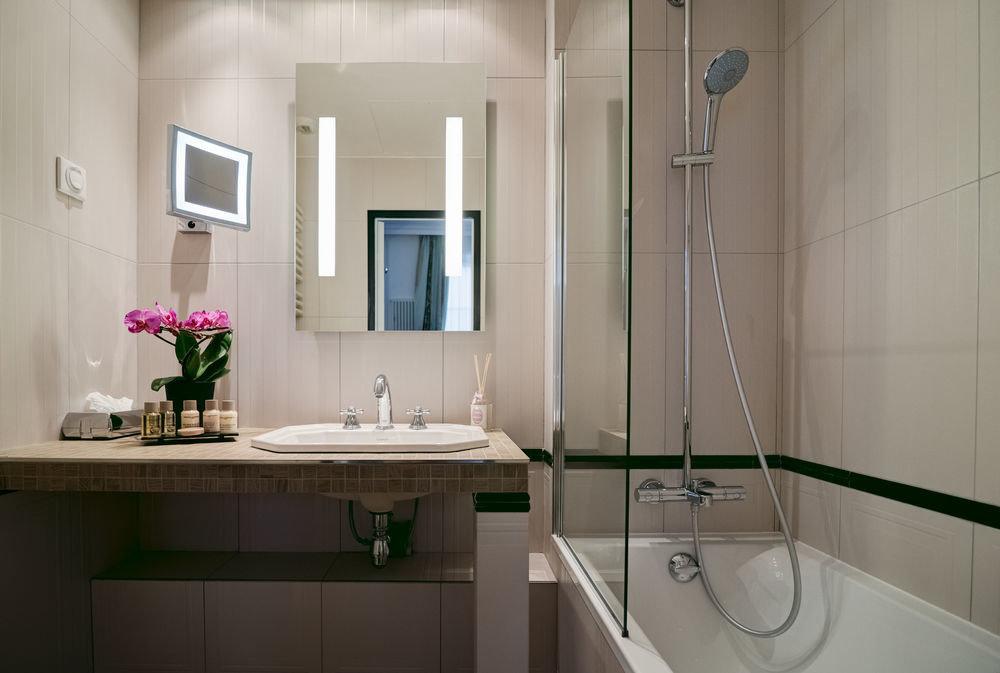 bathroom property sink toilet home flooring plumbing fixture tub Bath bathtub