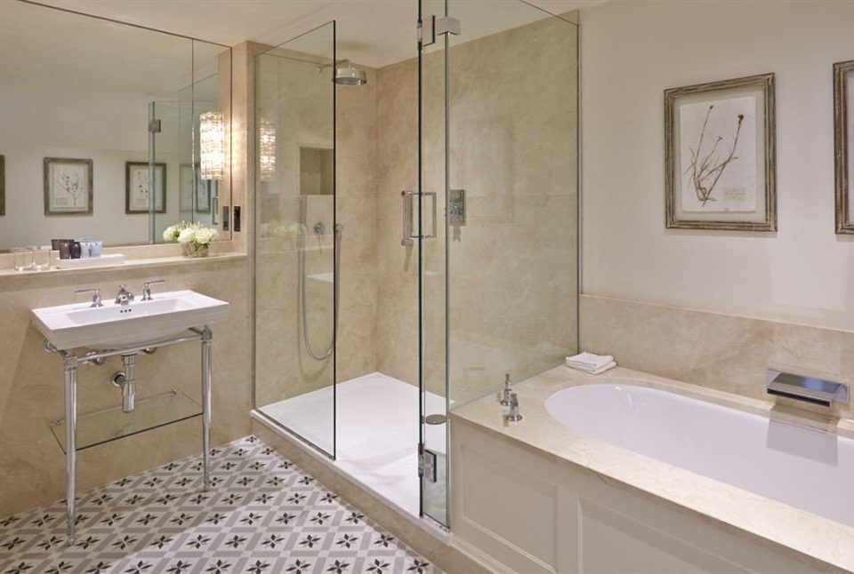 bathroom mirror property sink scene plumbing fixture home flooring tile bathtub tub tan Bath