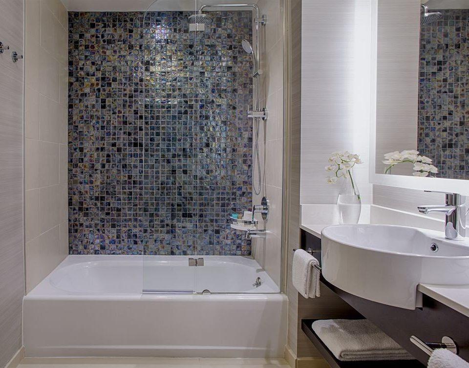 bathroom tub bathtub sink plumbing fixture flooring tile Bath tiled toilet
