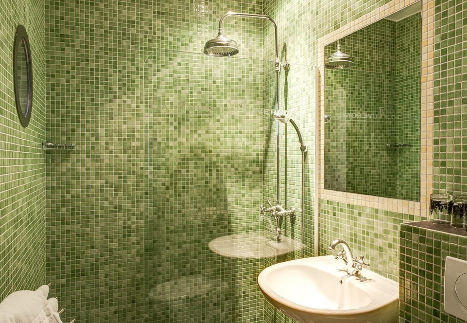 bathroom green sink tiled toilet tile flooring plumbing fixture tub Bath bathtub