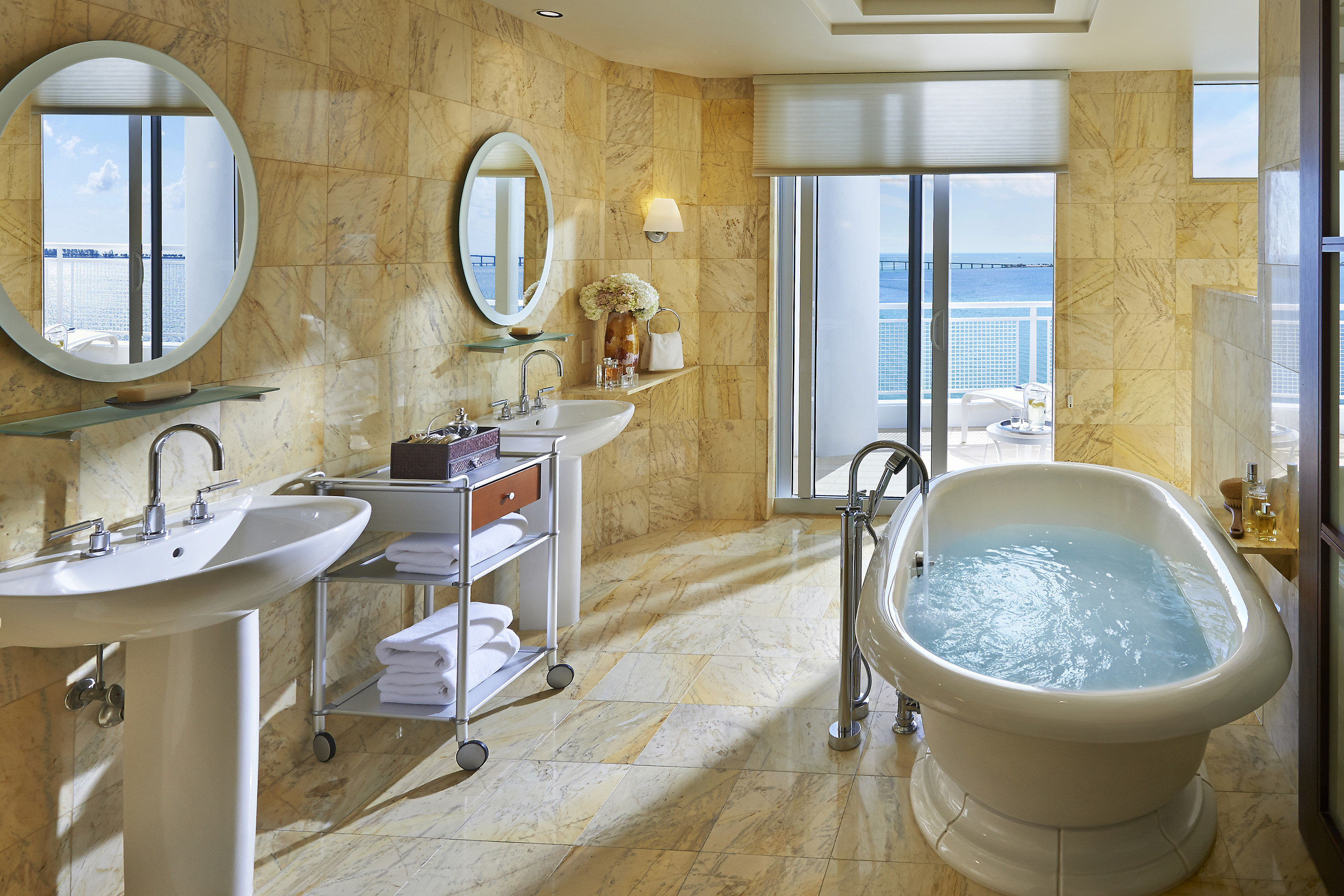 bathroom property sink home tub plumbing fixture tile bathtub flooring Bath tiled