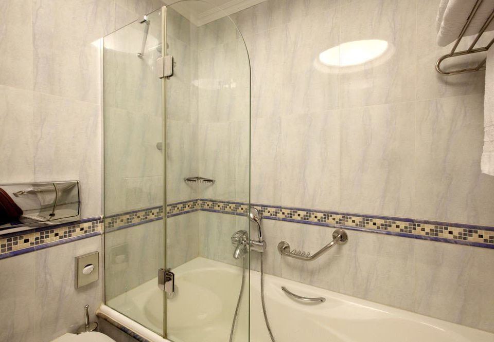 bathroom sink property mirror toilet scene plumbing fixture bathtub tub Bath flooring tile tiled