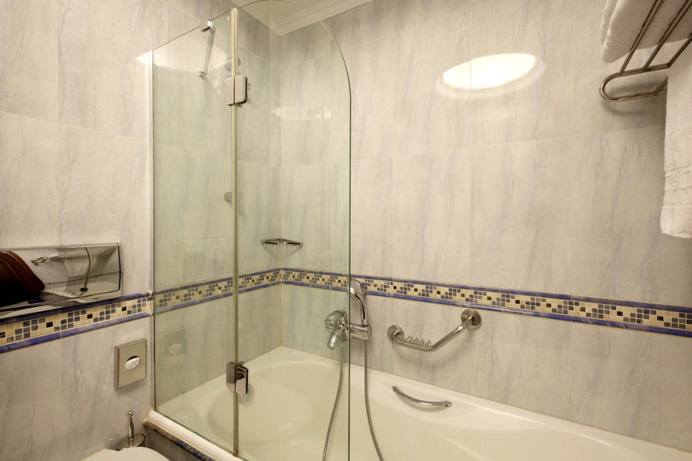 bathroom sink property mirror toilet scene plumbing fixture bathtub tub Bath flooring tile tiled