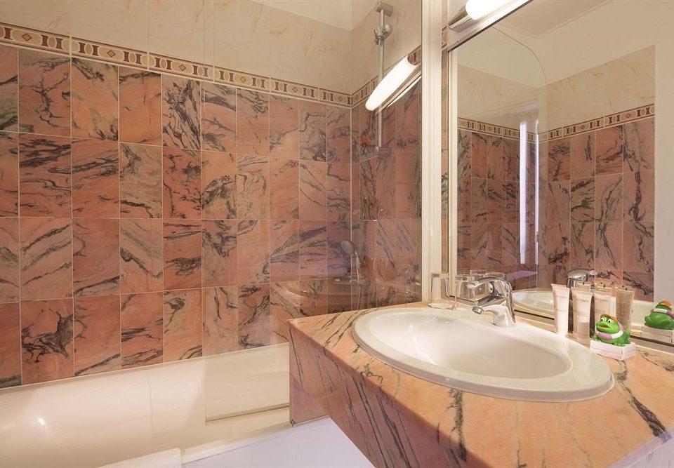 bathroom sink property tub flooring plumbing fixture tile bathtub Bath tiled
