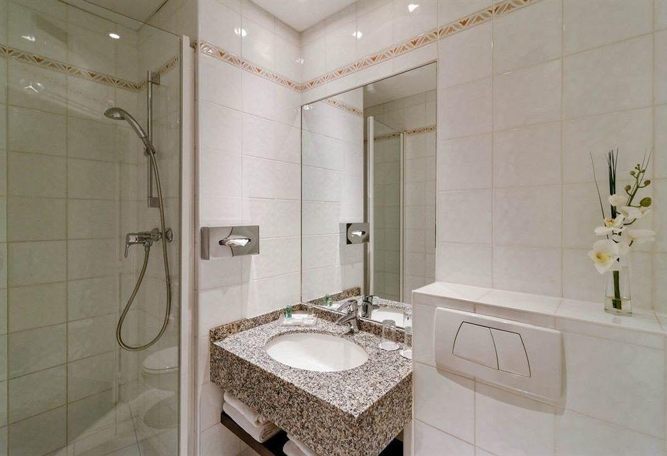 bathroom toilet mirror sink property shower tiled tile flooring plumbing fixture vessel tan tub Bath bathtub water basin