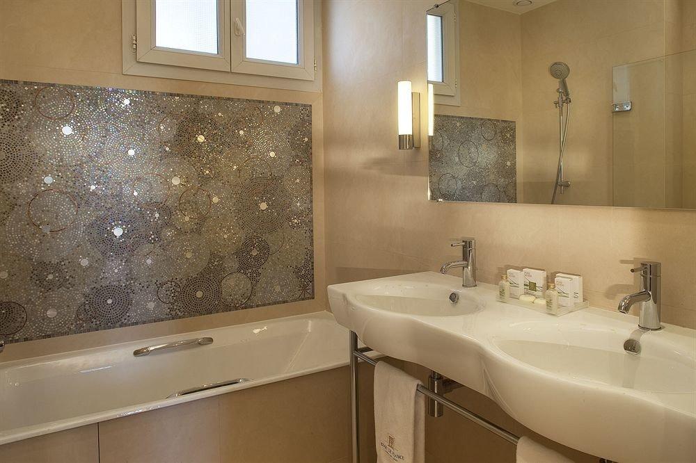 bathroom sink property home toilet flooring plumbing fixture bathtub tub tile tan Bath tiled