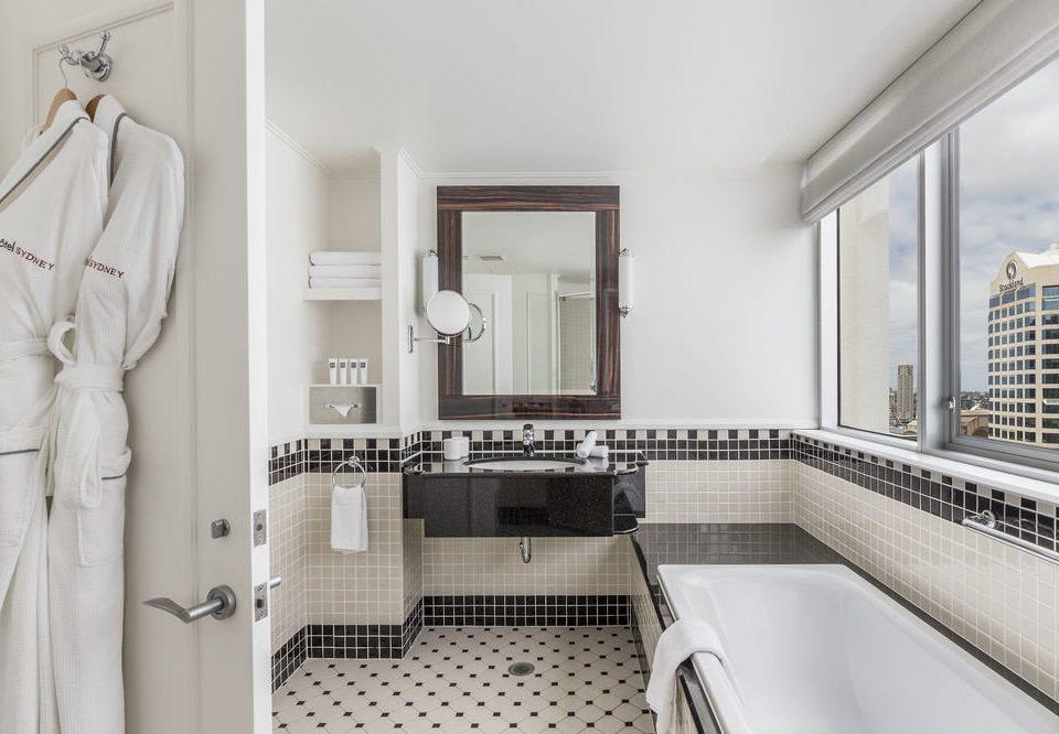 bathroom property sink white home flooring toilet tub tile tiled bathtub Bath