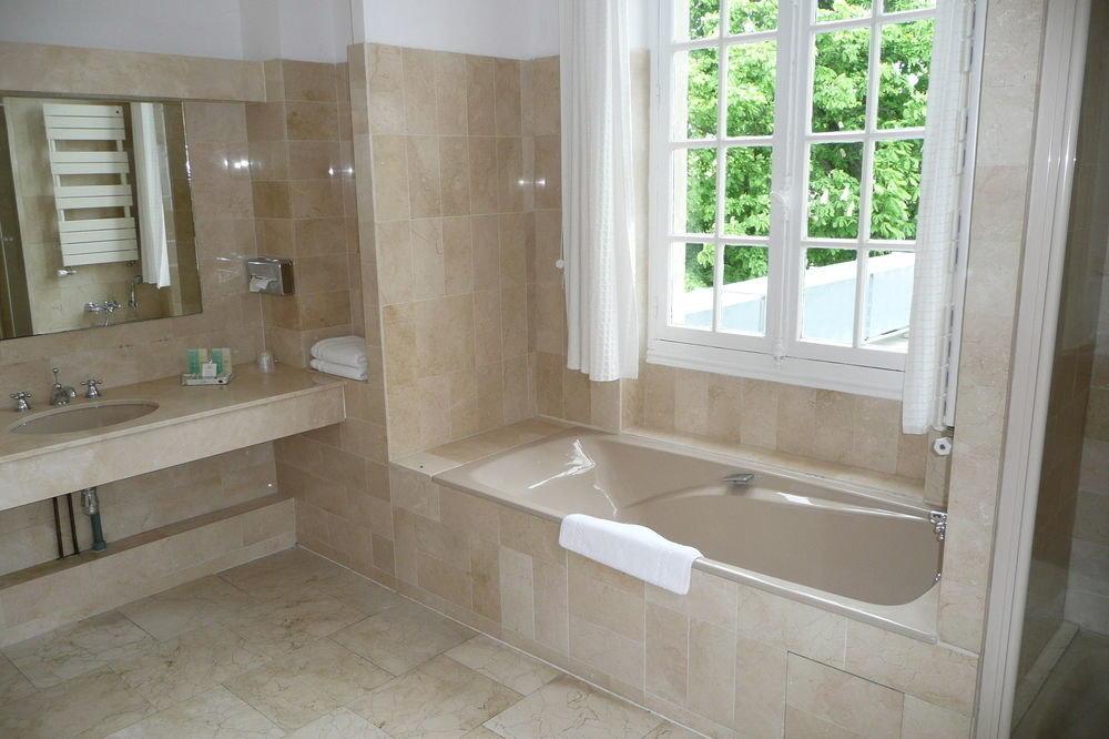 bathroom sink property plumbing fixture home bathtub flooring tub tile Bath tiled