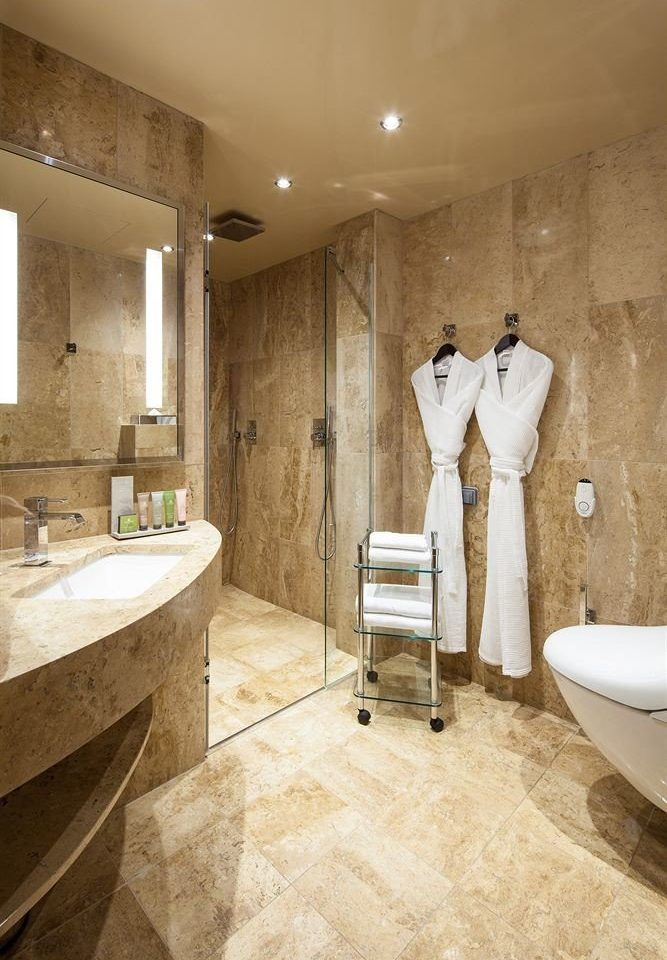 bathroom toilet property sink plumbing fixture bathtub home flooring Bath tub