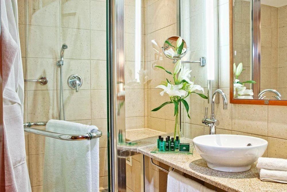 bathroom sink scene home plumbing fixture shower toilet towel flooring tub Bath bathtub