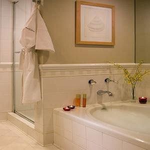 bathroom sink white towel plumbing fixture flooring tub Bath tile bathtub