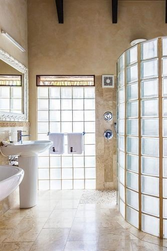 bathroom property flooring tub tile home tiled sink toilet bathtub Bath