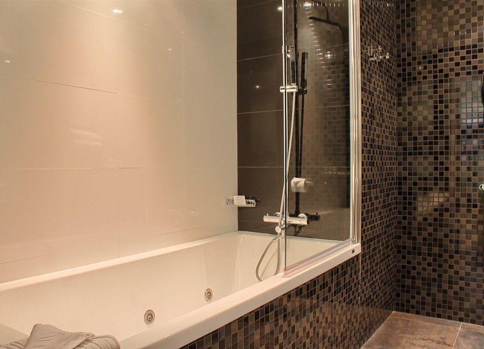 bathroom toilet plumbing fixture bathtub shower tile flooring tub tiled Bath
