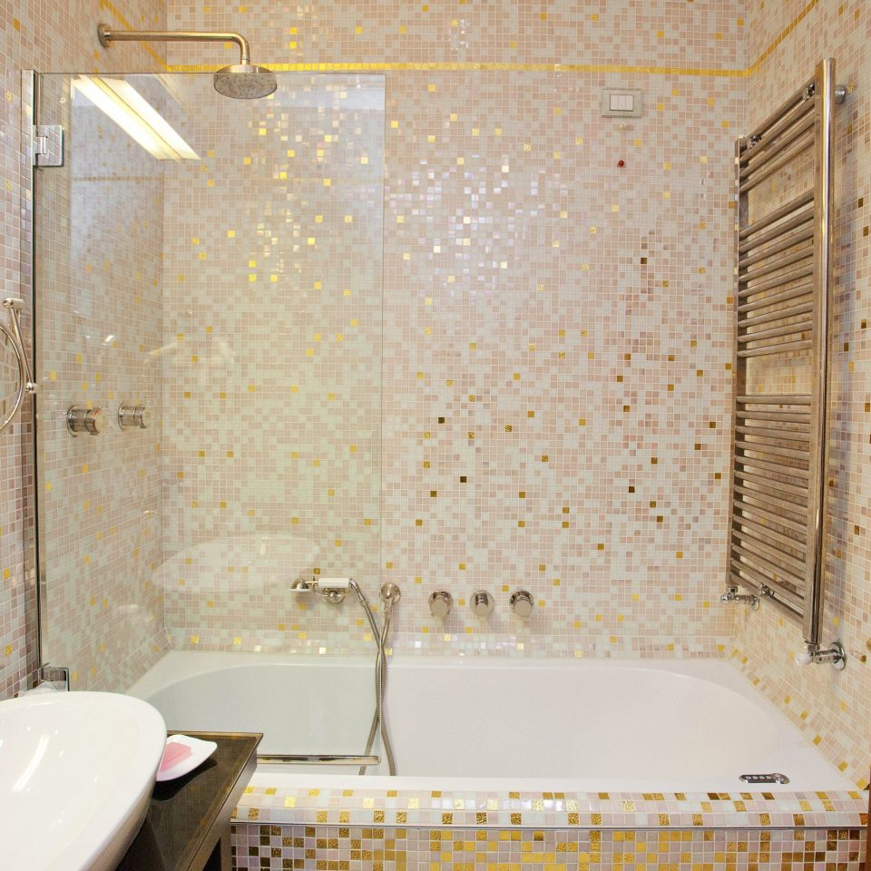 bathroom sink bathtub plumbing fixture toilet flooring tile swimming pool tub Bath tiled