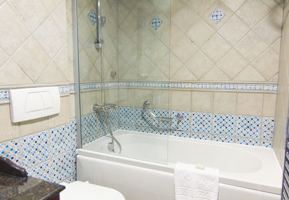 bathroom swimming pool property bathtub tub plumbing fixture tile tiled toilet flooring jacuzzi vessel Bath