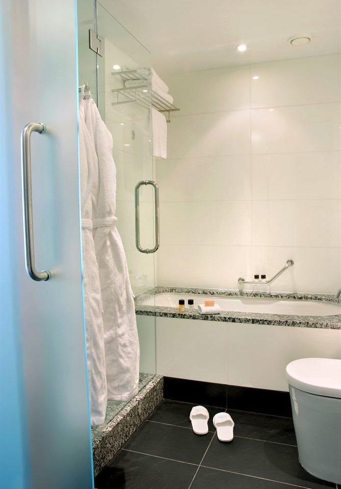 bathroom toilet plumbing fixture scene bathtub flooring Bath tile tiled