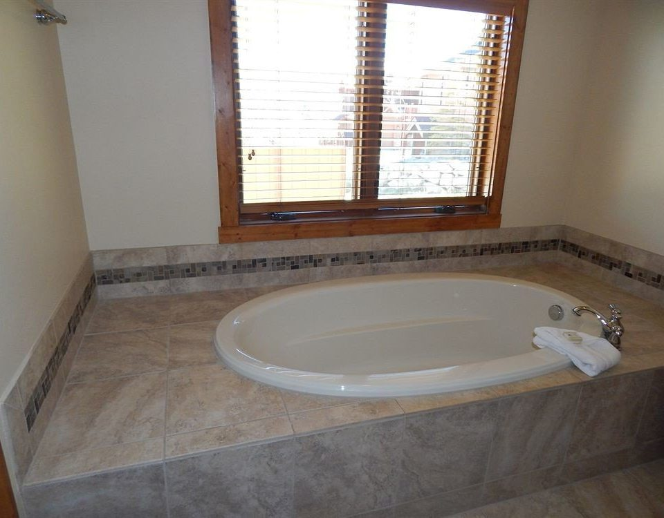 bathroom property tub swimming pool bathtub sink jacuzzi hardwood flooring plumbing fixture Bath tile tiled
