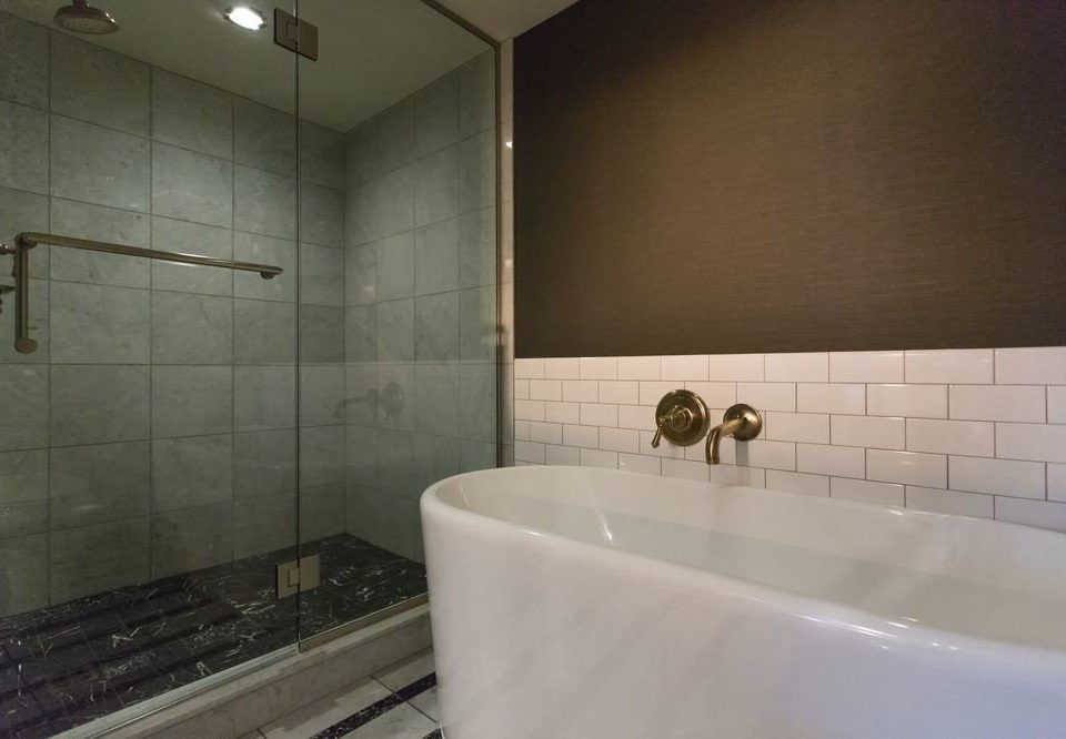 bathroom sink bathtub toilet plumbing fixture swimming pool tile flooring vessel tiled water basin tub Bath