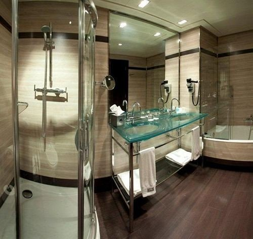 bathroom property swimming pool plumbing fixture toilet sink bathtub flooring tub Bath tile