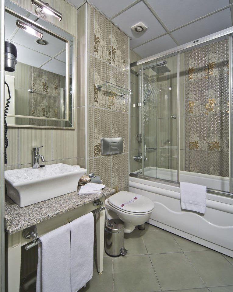 bathroom sink property flooring home tile toilet plumbing fixture bathtub tiled Bath
