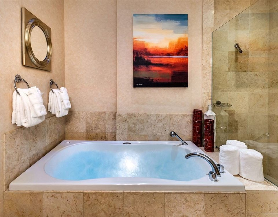 bathroom swimming pool bathtub sink plumbing fixture vessel jacuzzi tub flooring Bath tiled