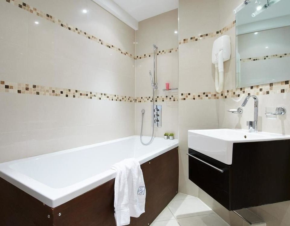 bathroom property white bathtub plumbing fixture sink flooring tub Bath tiled