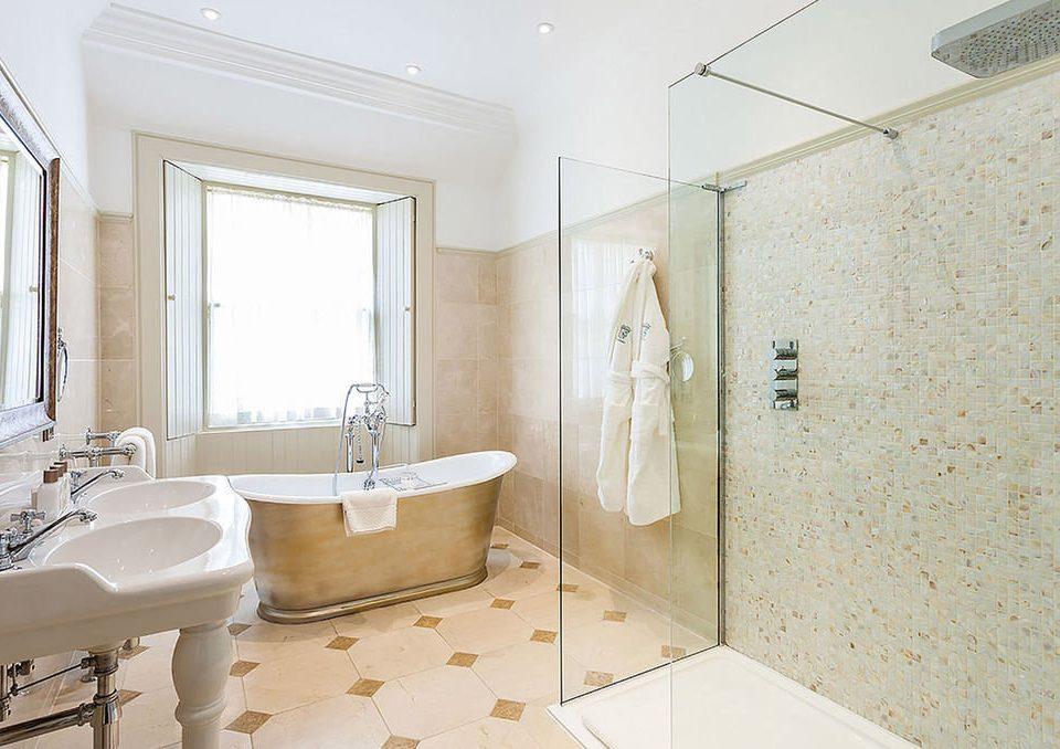 bathroom property sink plumbing fixture bathtub flooring tub tile Bath tiled