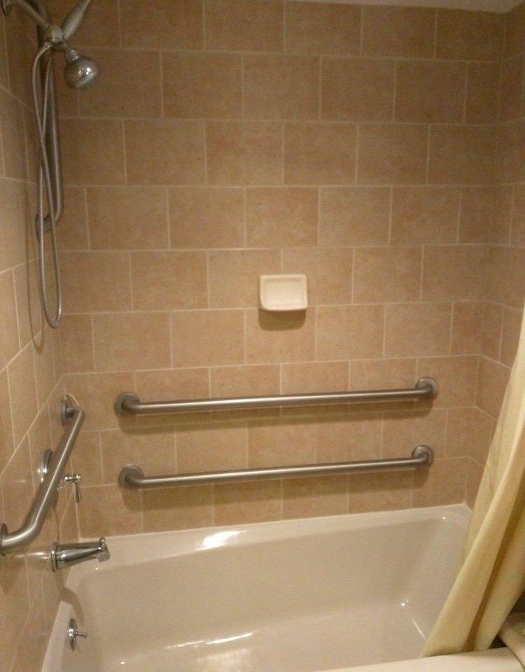 bathroom man made object toilet bathtub plumbing fixture sink swimming pool flooring tub Bath tiled