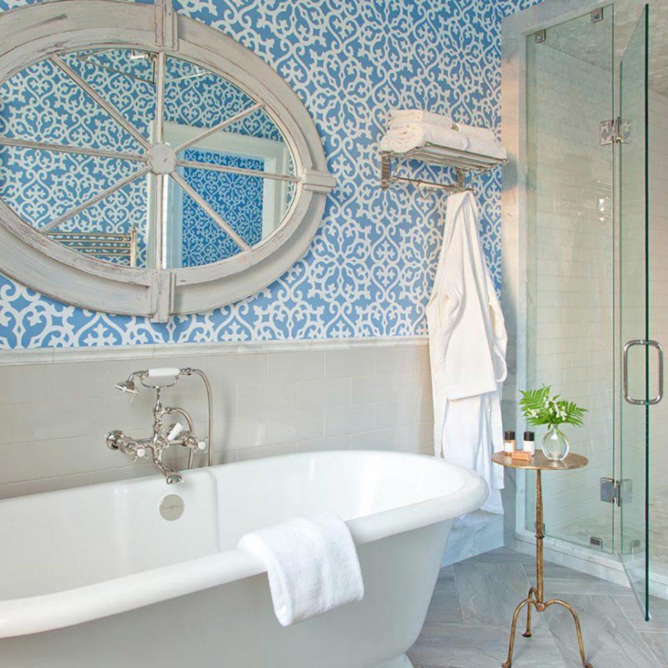 bathroom tub bathtub vessel Bath plumbing fixture flooring tile tiled