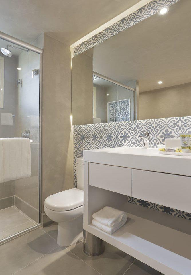 bathroom mirror sink property toilet flooring plumbing fixture tile Bath tub tiled bathtub