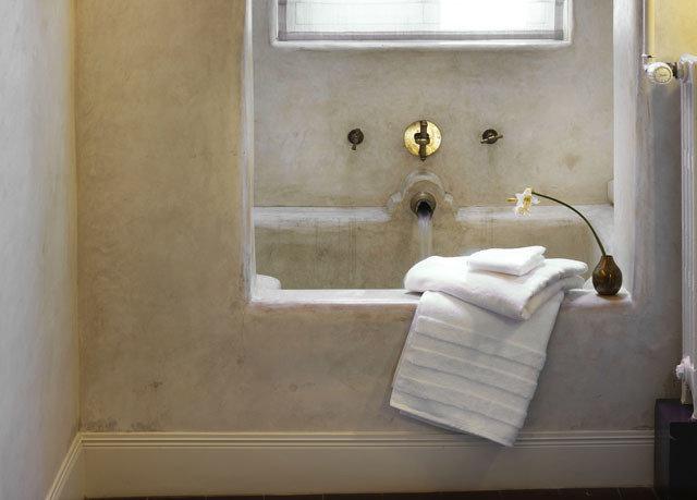 bathroom property house plumbing fixture home white flooring sink toilet bathtub tub Bath