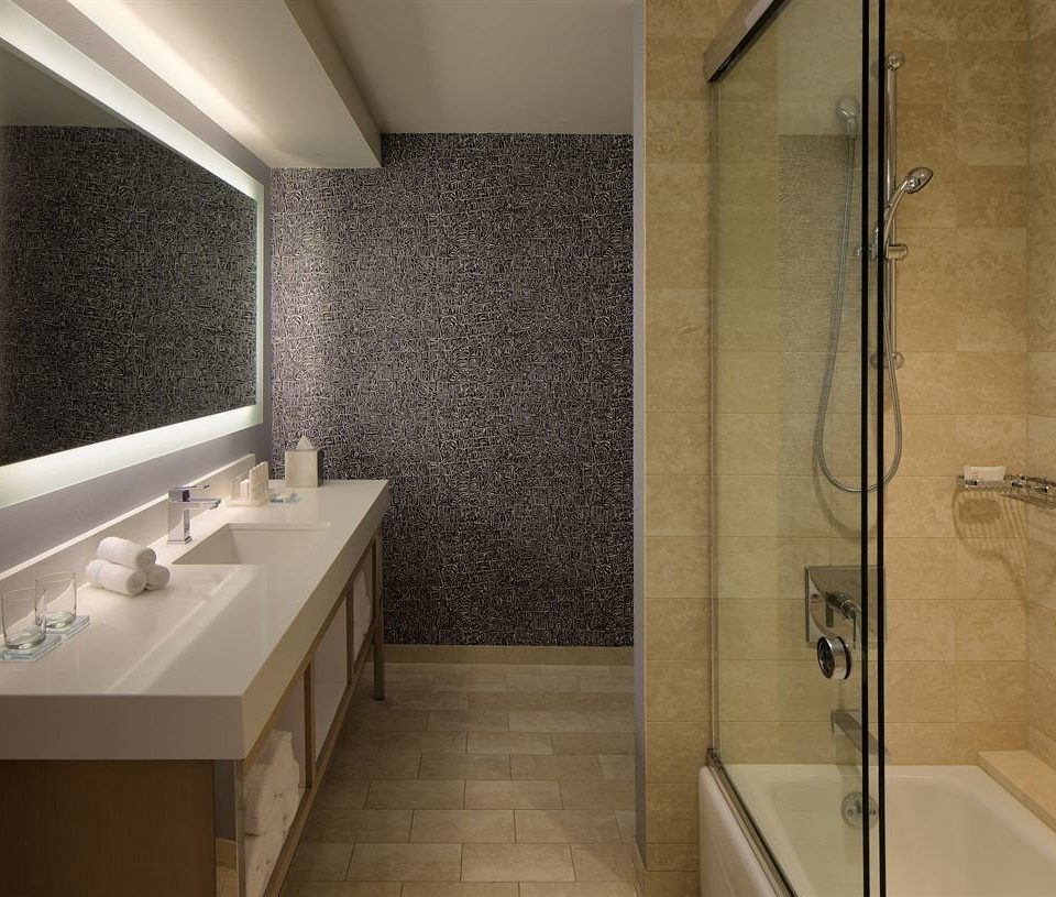 bathroom property sink flooring tile plumbing fixture toilet tiled white tub bathtub Bath
