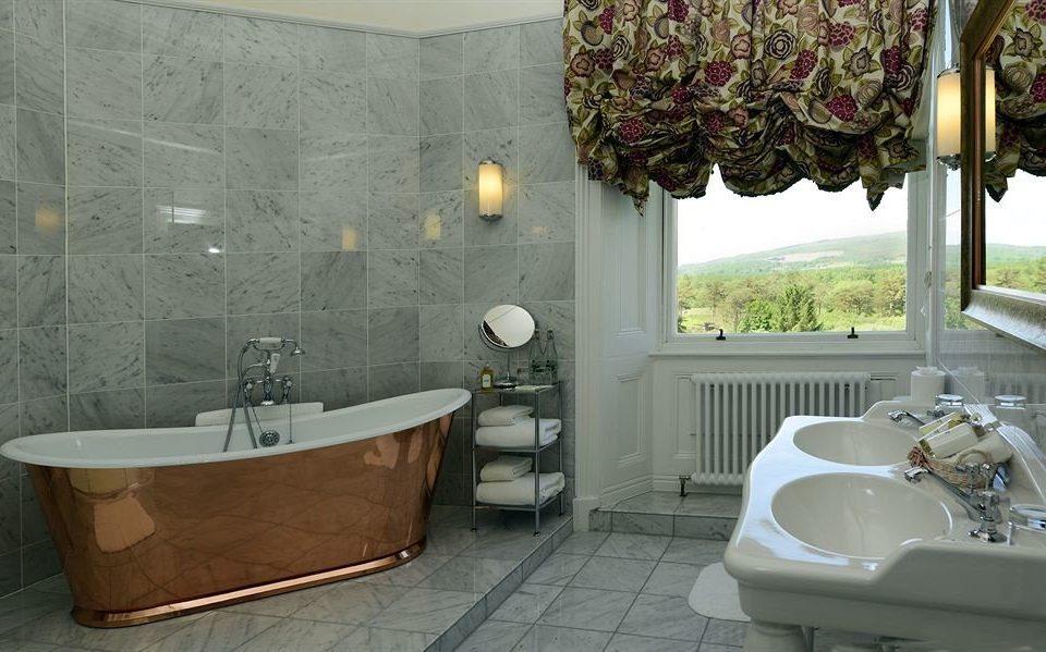 bathroom property sink home toilet tub tile Bath bathtub tiled