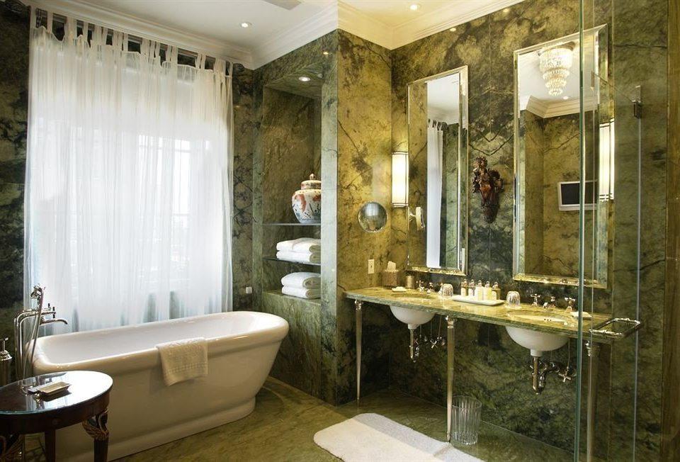 bathroom property sink home mansion tub Bath tiled bathtub tan