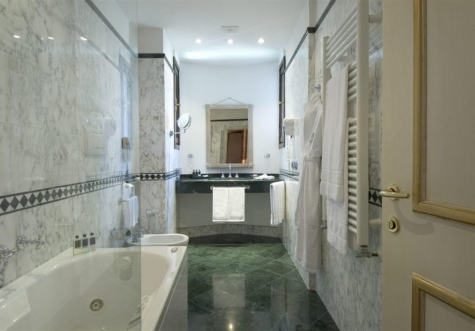bathroom mirror property sink toilet home white tub vessel mansion plumbing fixture bathtub Bath tile tiled