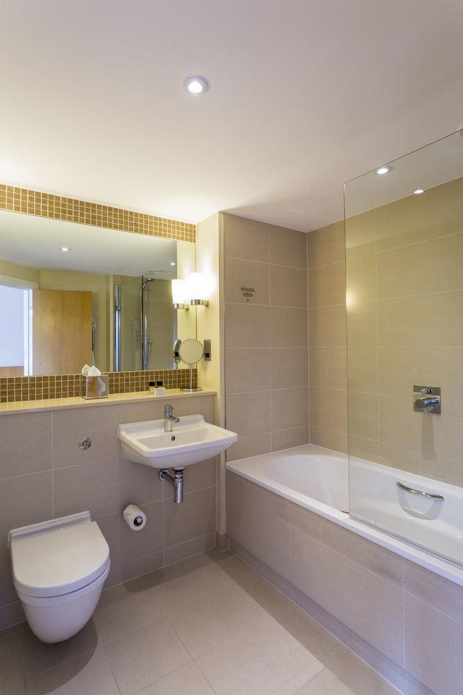 bathroom sink property toilet home Bath tile tub bathtub tiled tan