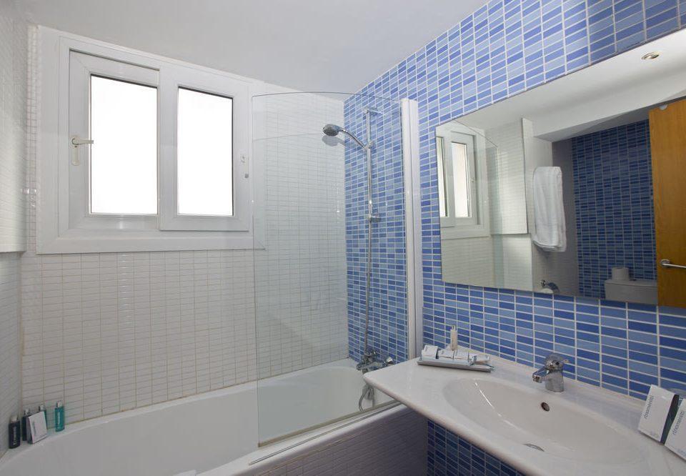 bathroom sink property tub bathtub swimming pool vessel home tile toilet tiled Bath